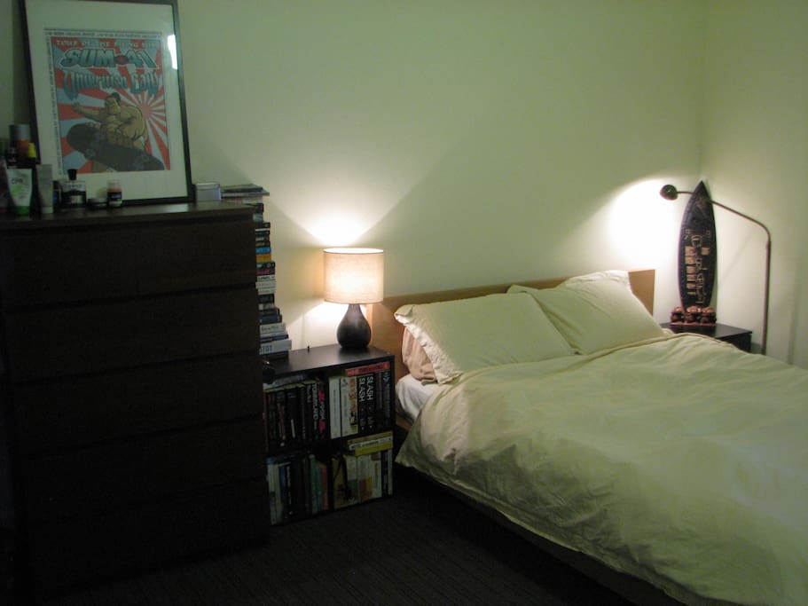 Super comfy queen size bed with reading lights.