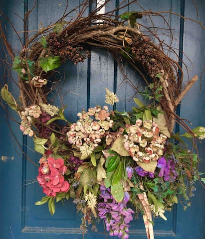 A lovely spring wreath against the jewel blue front door of the farmhouse.