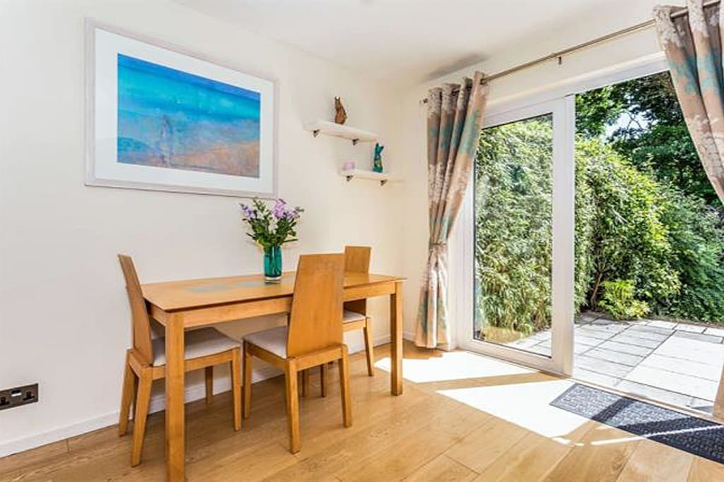 Our light and airy dining room with french doors that open out into our enclosed back garden