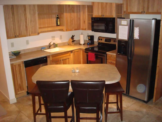 Fully-equipped and super clean kitchen with stainless steel appliances
