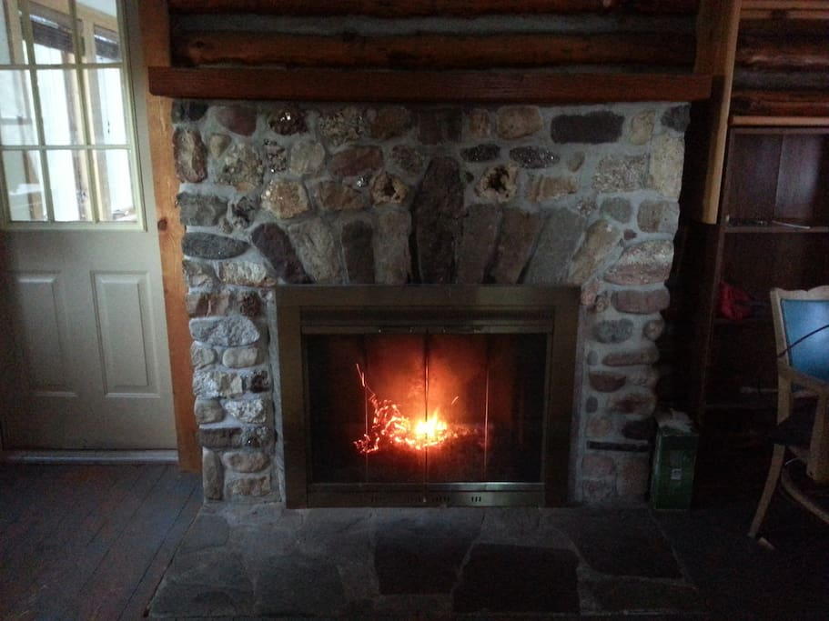 Warm your spirits in front of the Fireplace.