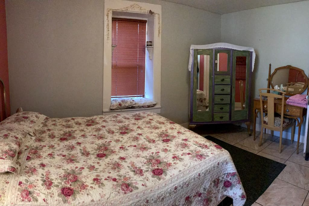 Comfortable queen in a classic adobe house- 24 inch walls mean quiet, restful sleep.