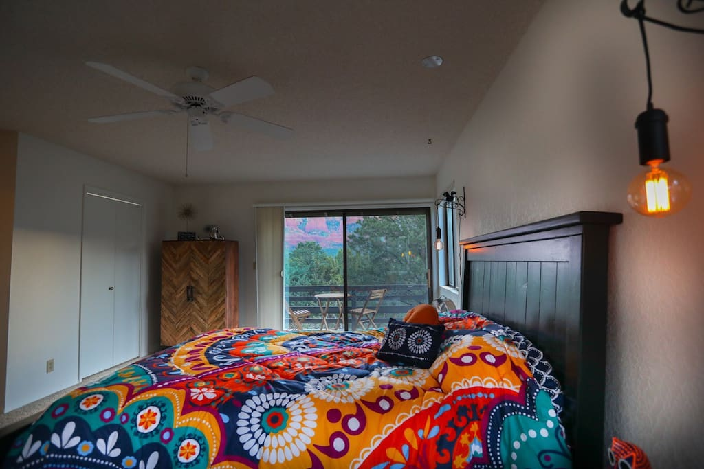 Black bedroom, Amazing view out 3 windows, a deck with table and chairs, and a larger bathroom. Washer and dryer are also in the bathroom.