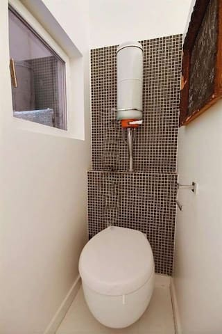 Bathroom   The 5 square meters bathroom has a double glazed window facing courtyard . It is equipped with : washbasin, bathtub, toilet, built-in wall closet, hard wood floor.