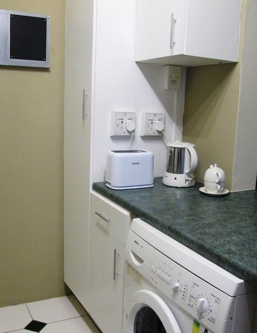 Well-equipped kitchen with oven, stove, microwave oven, washing machine, kettle toaster, all crockery, cutlery etc
