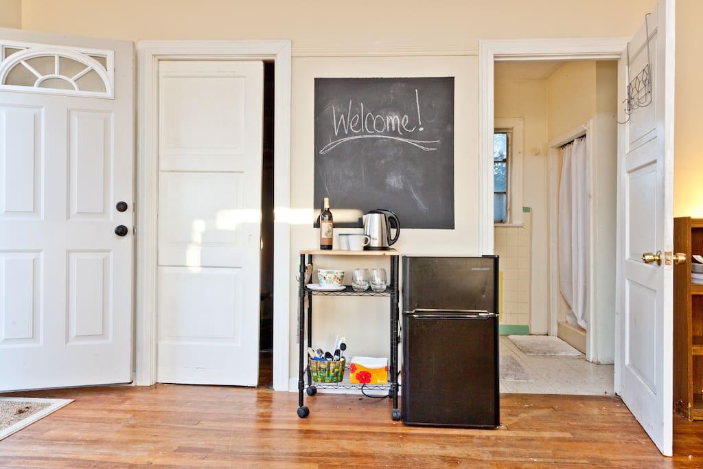 Spacious closet, mini kitchen and full bathroom.