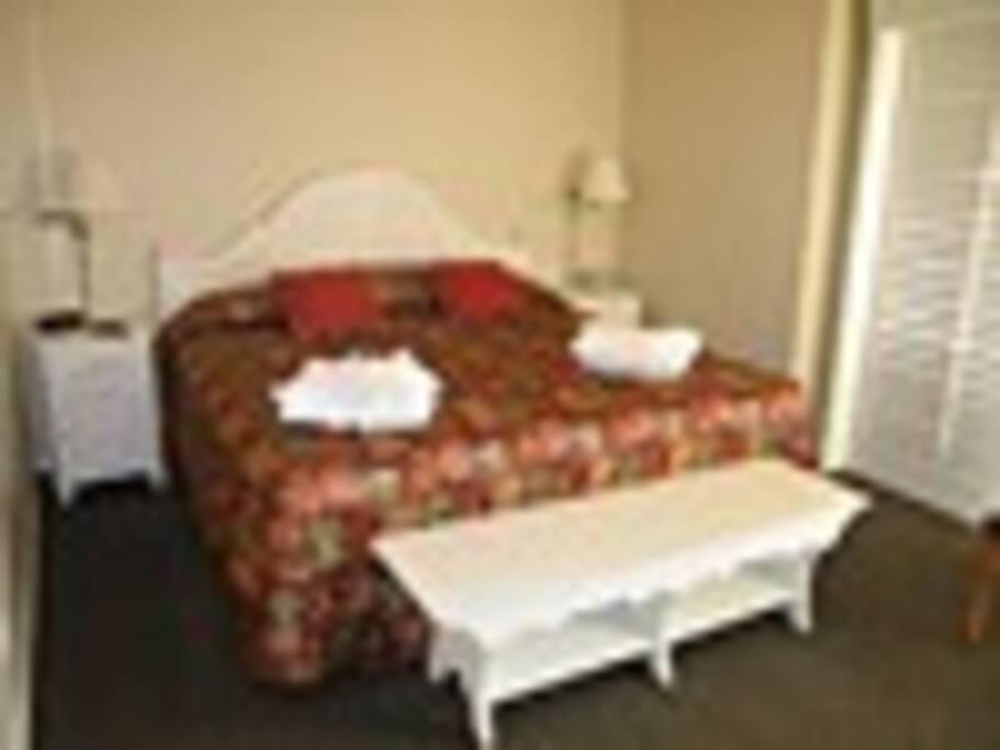 Main bedroom has queen bed.  Open nook has twin bunkbed.  Queen sofabed in livingroom.