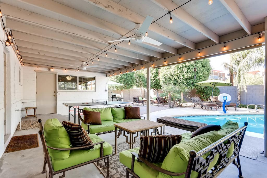 """Awesome backyard with covered patio, ping pong table, 4 Burner BBQ Grill, 47"""" HDTV, Ceiling Fans, and pool with surrounding trees for peace and privacy!  Lots of seating!"""