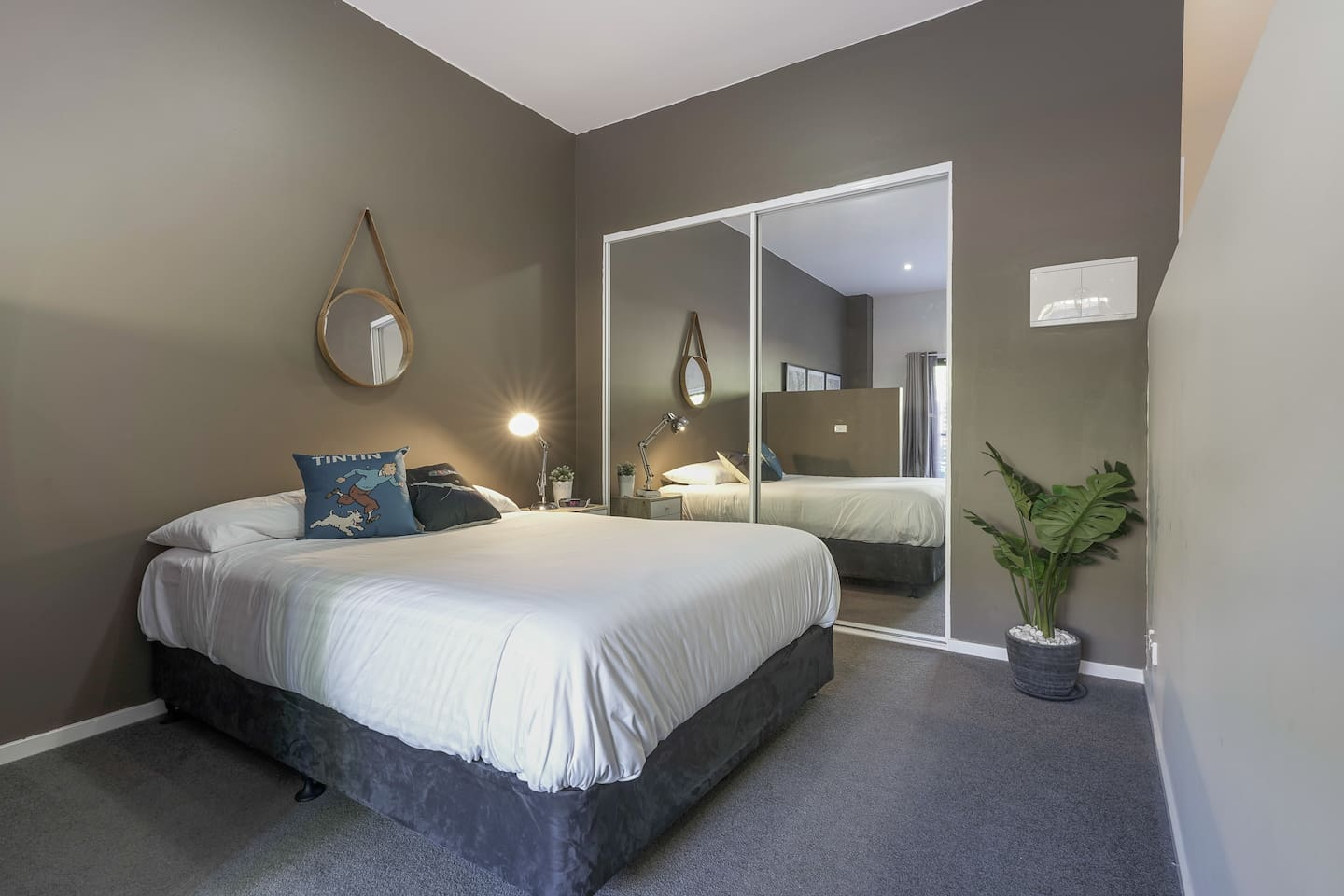 Very comfy bed with such a relaxing wall colors.