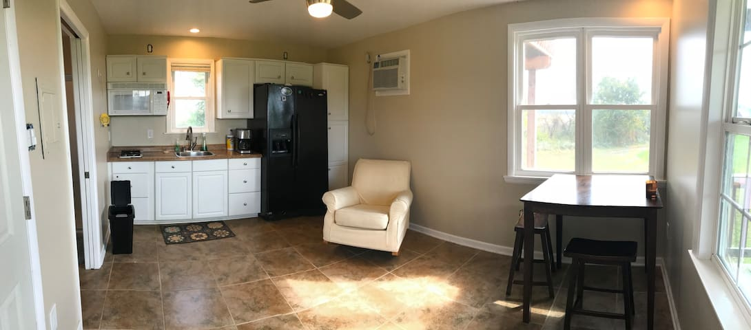 Kitchen with cooktop, microwave, sink and refrigerator