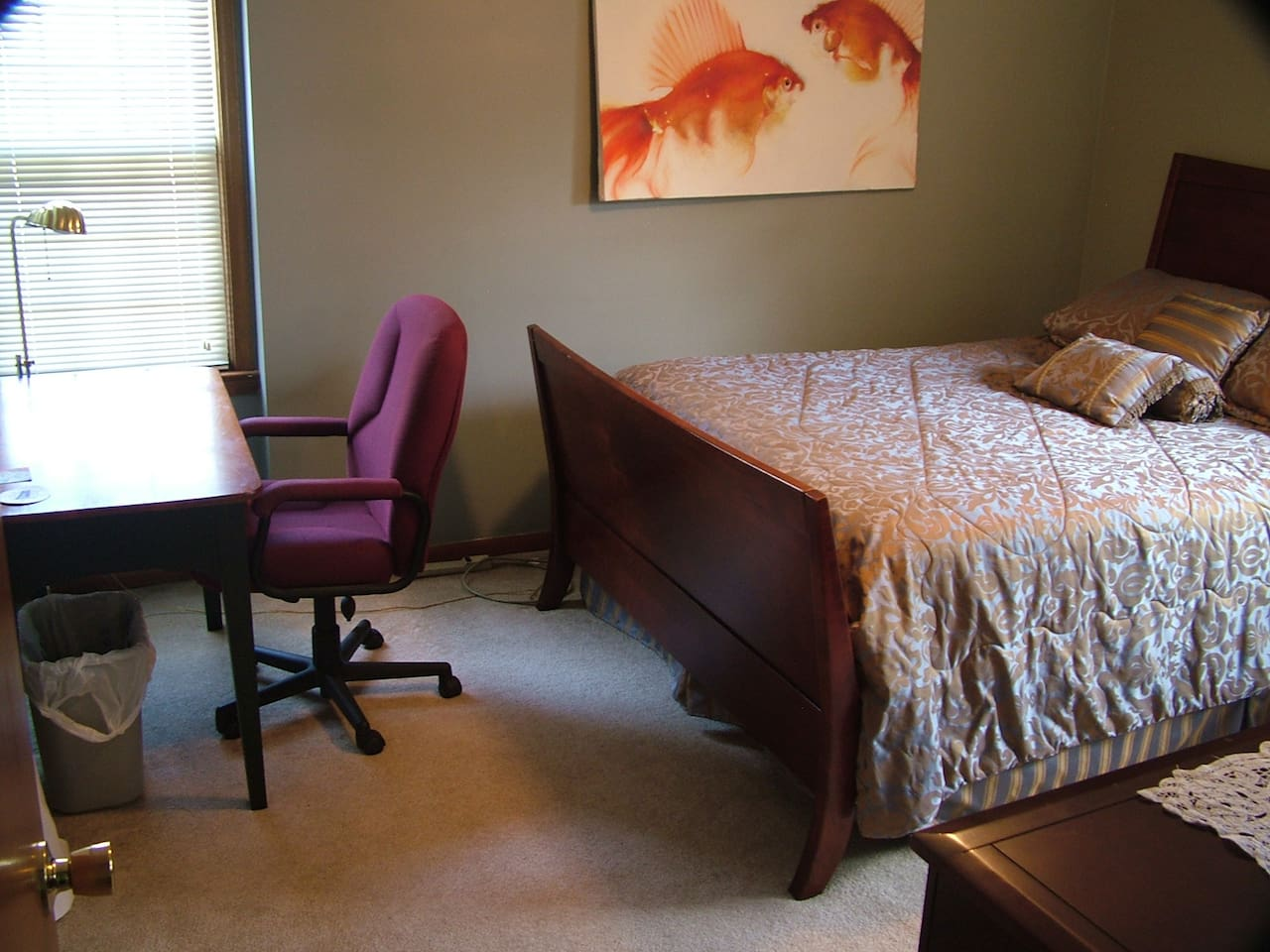 Desk, closet and large dresser with two reading lamps.