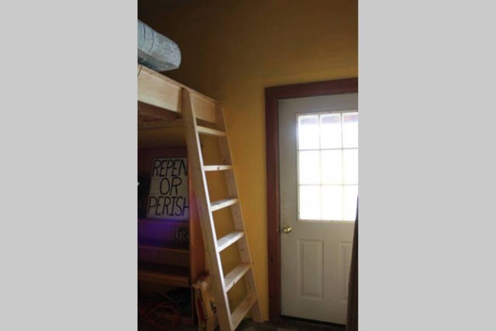 Side entrance, loft up ladder over laundry area.