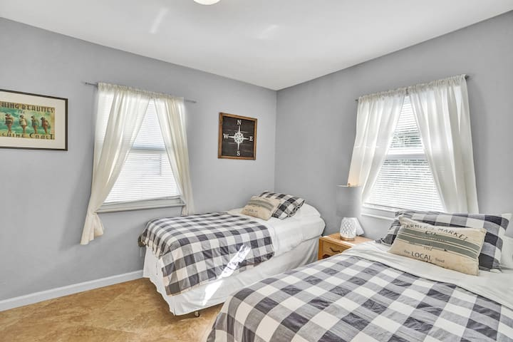 Kid's bedroom features two comfortable twin beds.