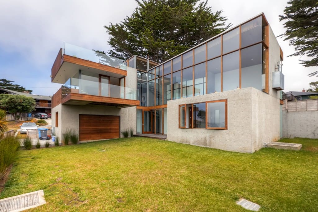 This Montara vacation rental home's unique exterior is completely green - primarily made out of Peruvian wood, steel, concrete and glass.