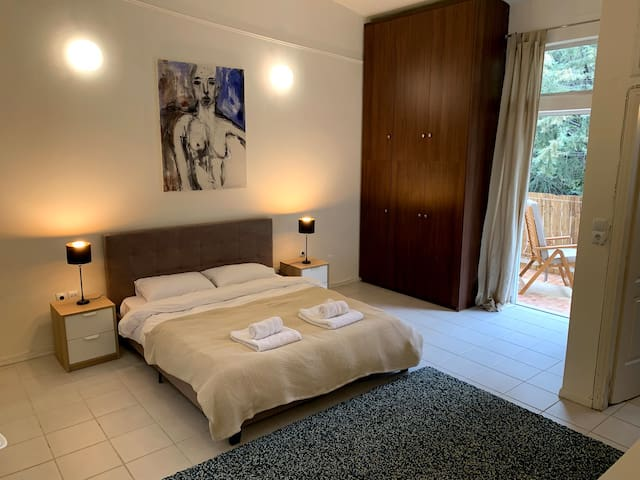 The bedroom with en-suite bathroom and balcony.