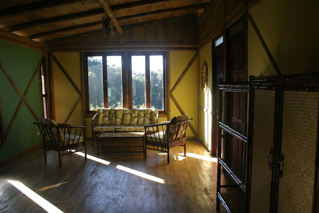 Bamboo frame, floors, and furniture. The walls are PlyRock, recycled fiber and concrete