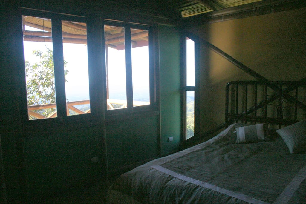 Bedroom and view to balcony