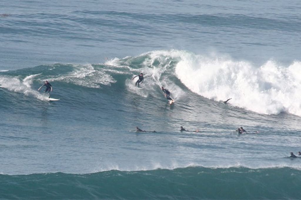 Zoomed in picture of the surfers- you can watch from the kitchen, dining and living rooms.