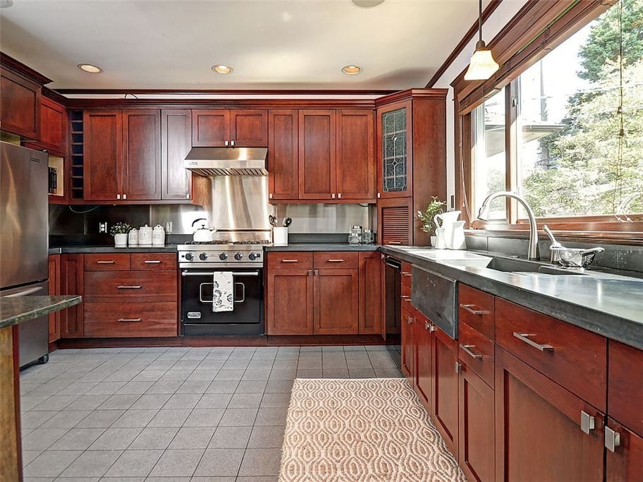 Large fully stocked kitchen and window looks out to back garden. Viking gas range