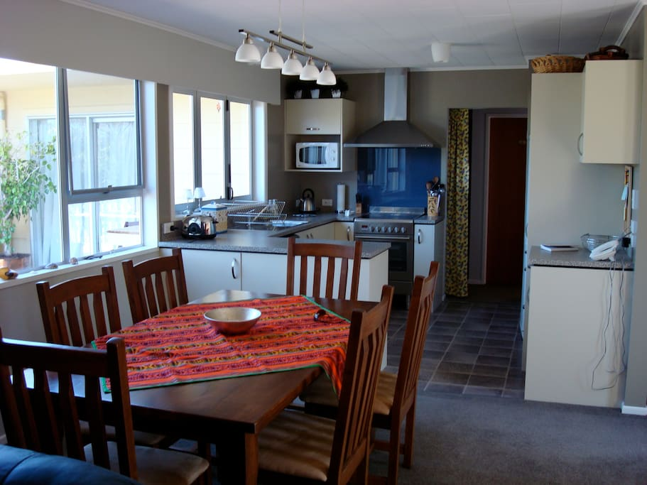 Open plan dining and Kitchen area..with serving area from kitchen window.