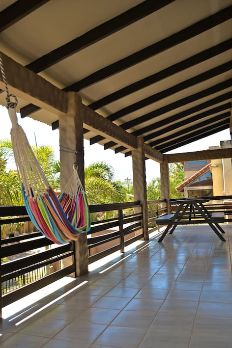 Upstairs Balcony with picnic table and hammock to relax