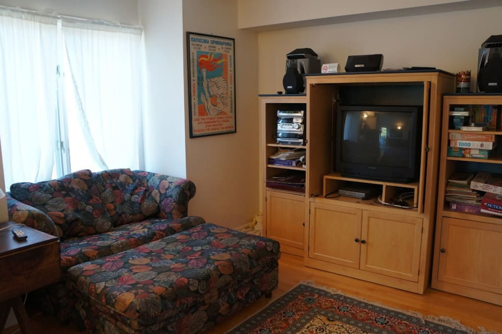 TV with VCR/DVD, loveseat, puzzles/games