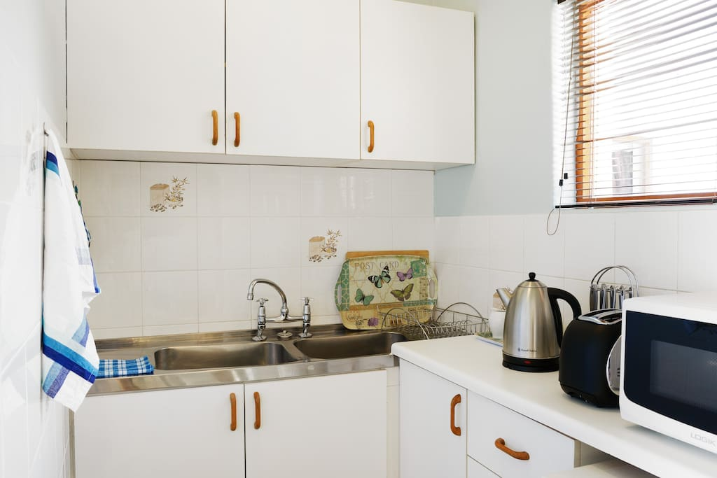 The kitchenette, complete with kettle (includes coffee, tea, sugar, etc), microwave, toaster, bar fridge, all cutlery and crockery. You'll find everything you need in here. If you don't - simply ask!