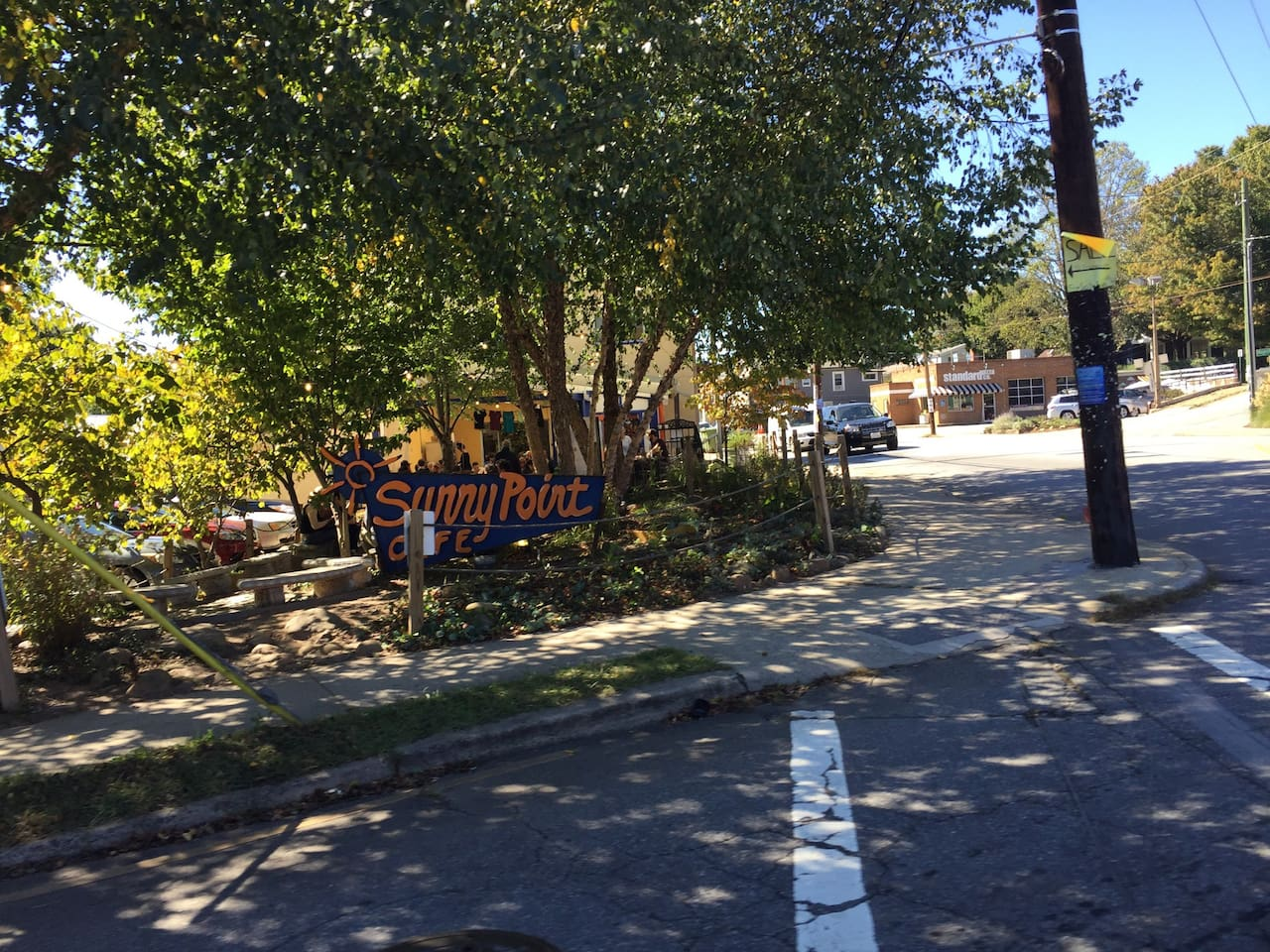 """Our place is only a ten minute walk to West Asheville shops and restaurants, such as Firestorm Books and Sunny Point Café (pictured here), on the corner of Haywood Road and State Street. One frequent visitor to Asheville commented, """"Amazing space in the best neighborhood in Asheville."""""""