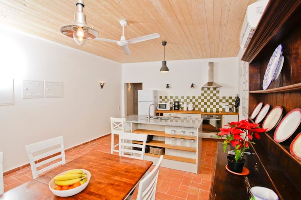 Kitchen dining room with air conditioning and ceiling fan