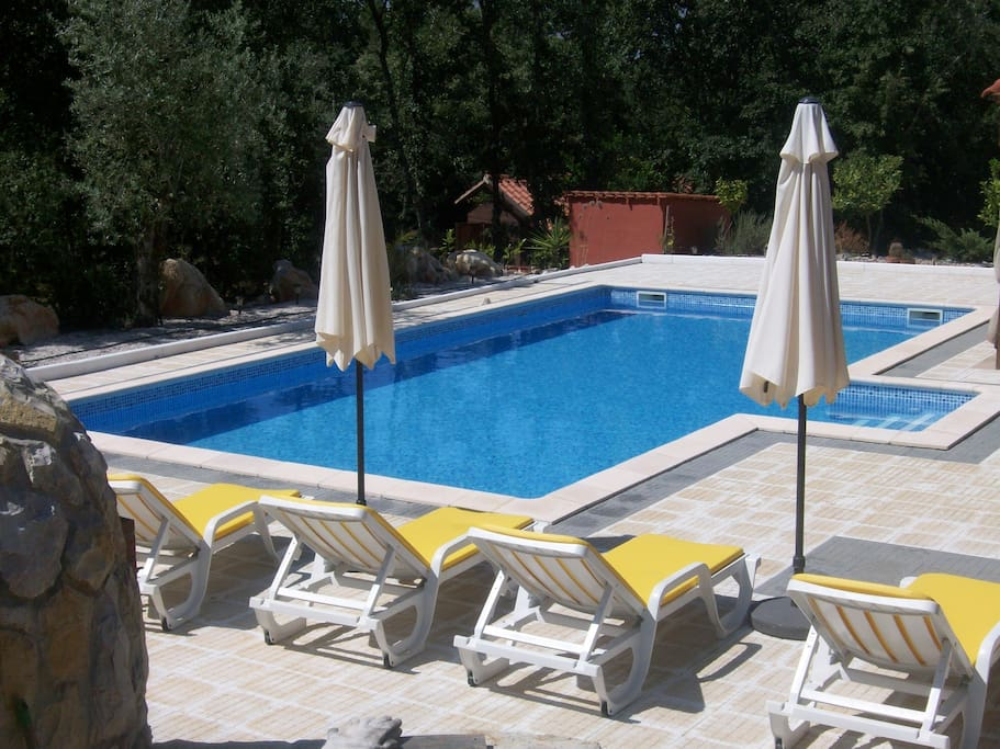 Large 10x5 swimming pool with ample sunbathing area ~ constant depth of 1.2 metres.