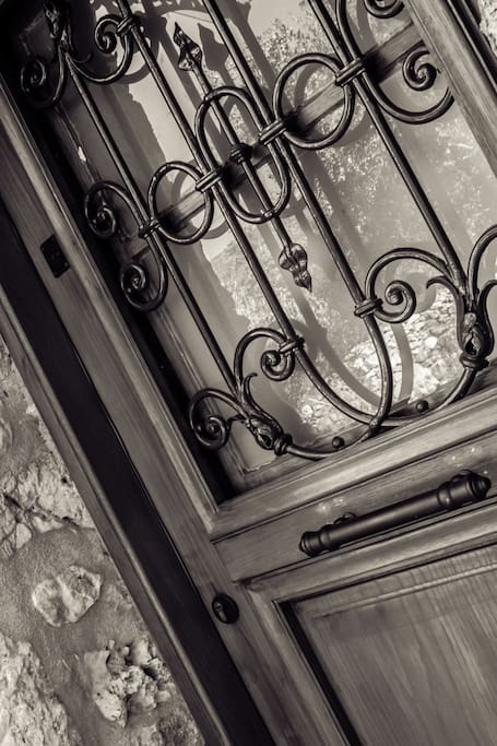 Same door but taken from a different angle, and light, knock knock again...The railing door goes back to the year 1870!