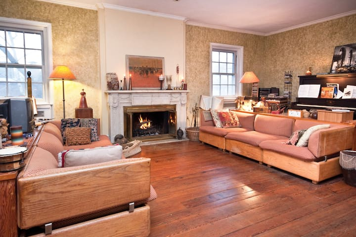 The random width pumpkin pine floors were reclaimed after WW2 from a Wanamaker mansion. Piano too.