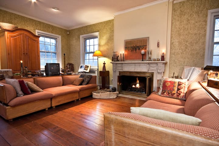 Carved marble fireplace!   Random width pumpkin pine floors!  Faux finishes on walls. Piano is to the right.