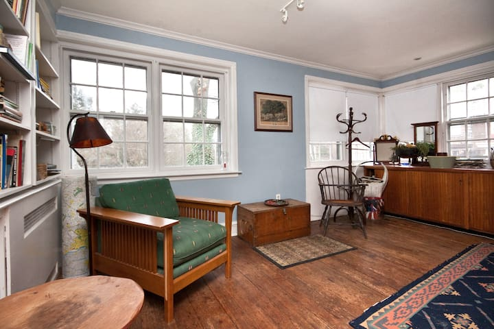 In the library/ study, five windows on two sides look out into the trees.  The home is the full 2nd floor.
