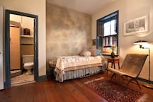 The faux finish was created by a top scenic artist.  The floors are historic.  Bathrm at left has a skylight.