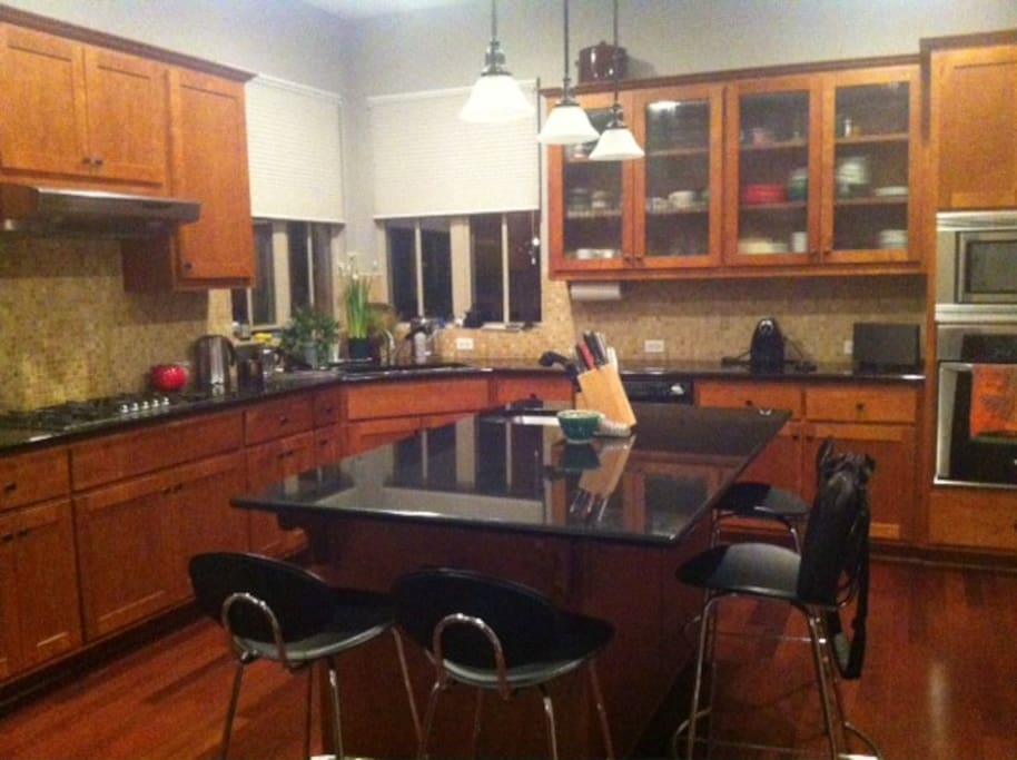 Large, fully-equipped kitchen with granite countertops and central island