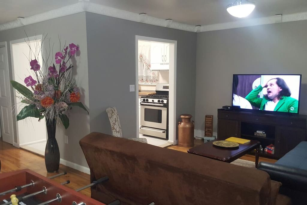 Comfortable and Spacious entertainment space. Don't worry about inflatable beds, you have 2 extra beds in this apartment! The couch opens up to a full sized bed, the sheets and pillow are ready for the next guest.