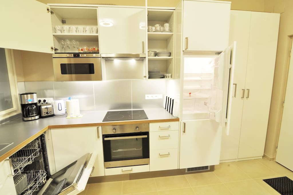 Kitchen is fully equipped, there are washing machine, oven, toaster, coffee machine, kettle, cooker and microwave oven
