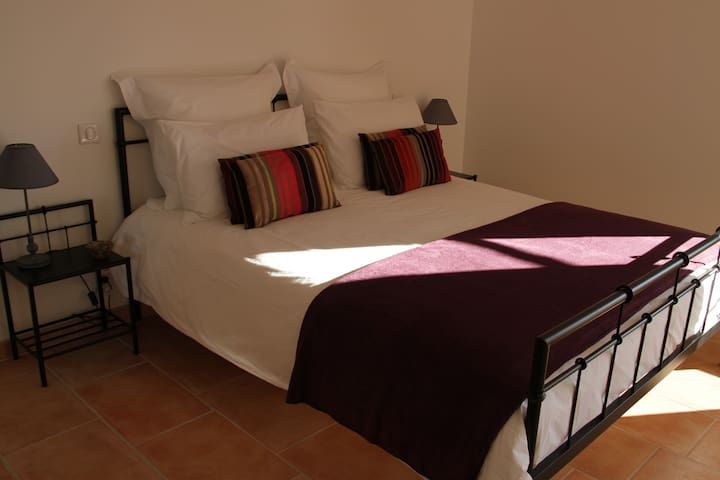 Comfortable king size bed with luxury linen
