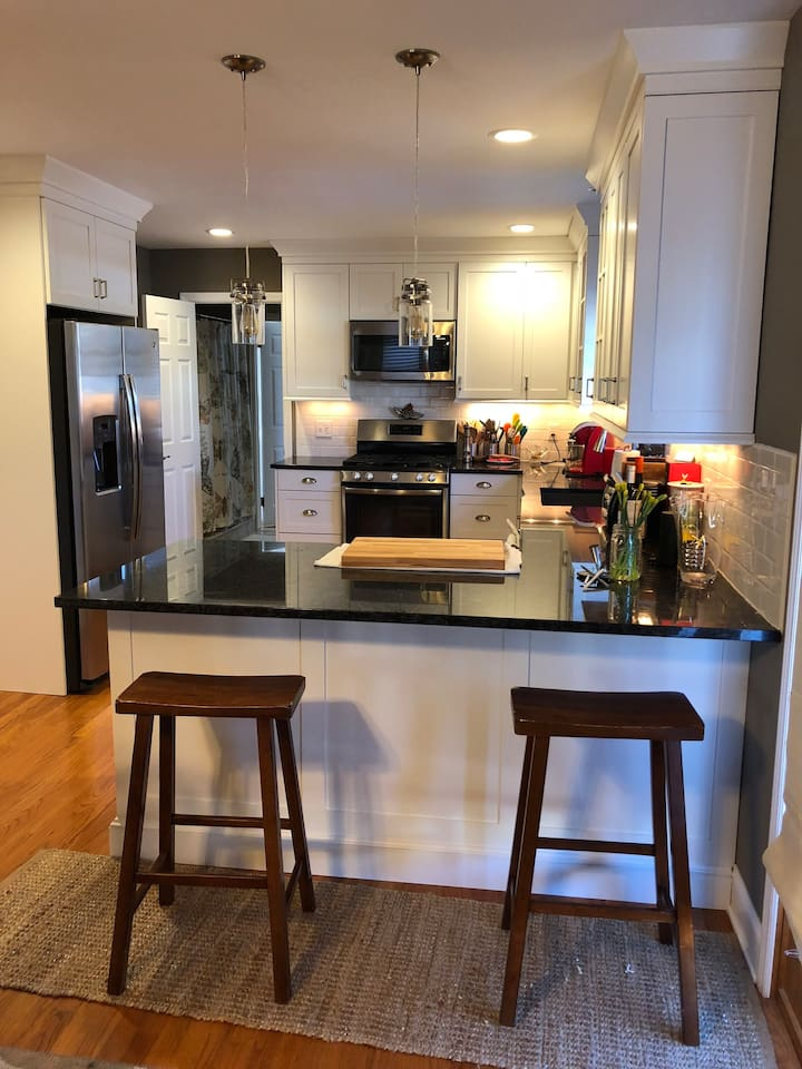 Brand new kitchen with endless countertops, new stainless steel appliances, bar seating