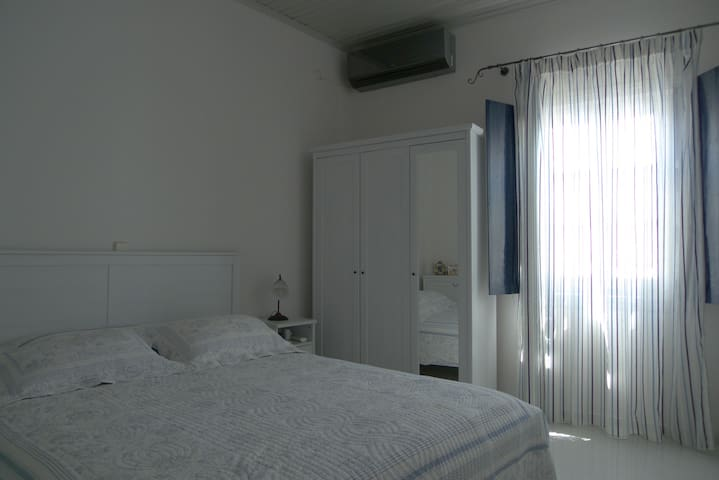 Master Bedroom with Double Bed and Air condition unit