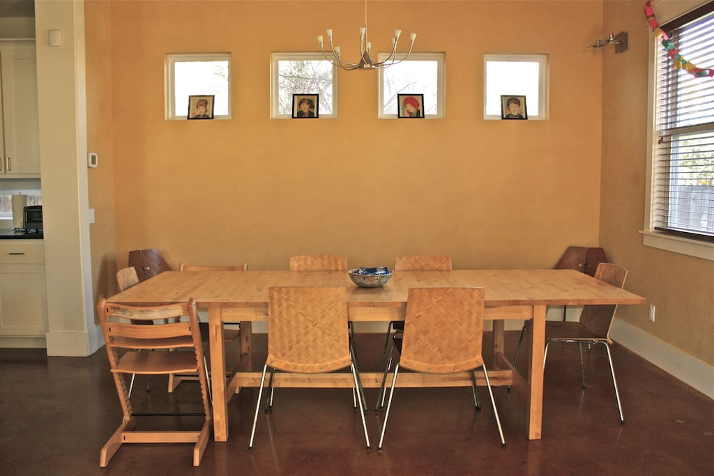Large dining area is open to the kitchen and living room. Table seats 10.