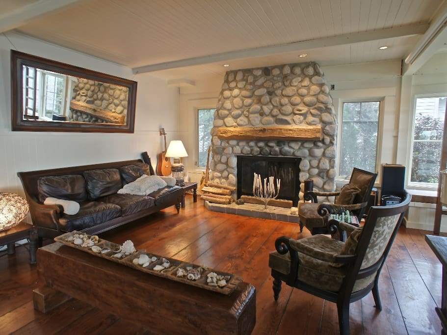 Main Floor Living Room with wood burning fire place great for watching storms.