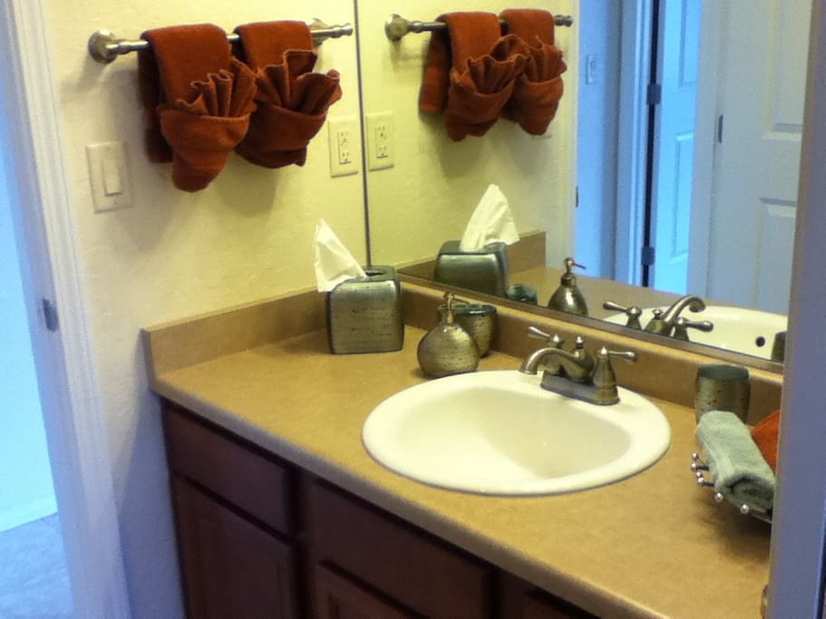 Large bathroom-just off this room is a connected bright   space with luxurious towels, bath tub/ shower and storage