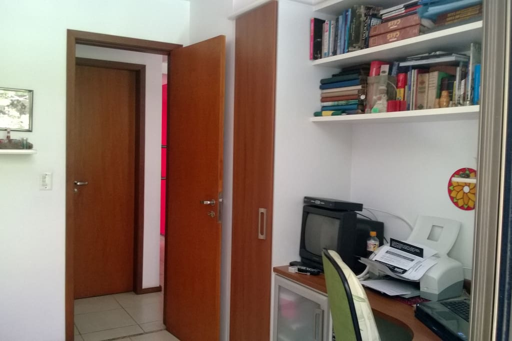 On the right the closet with the TV next to it and, in front of the room,  the bathroom.