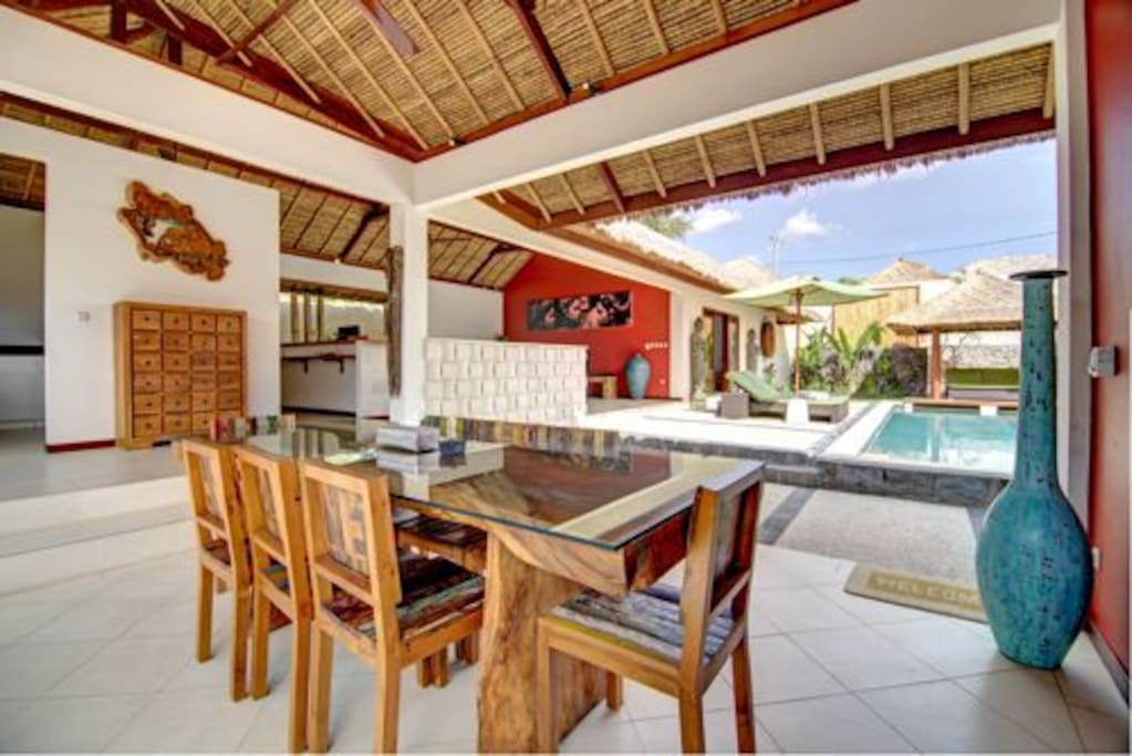 open dining room and kitchen with pool view