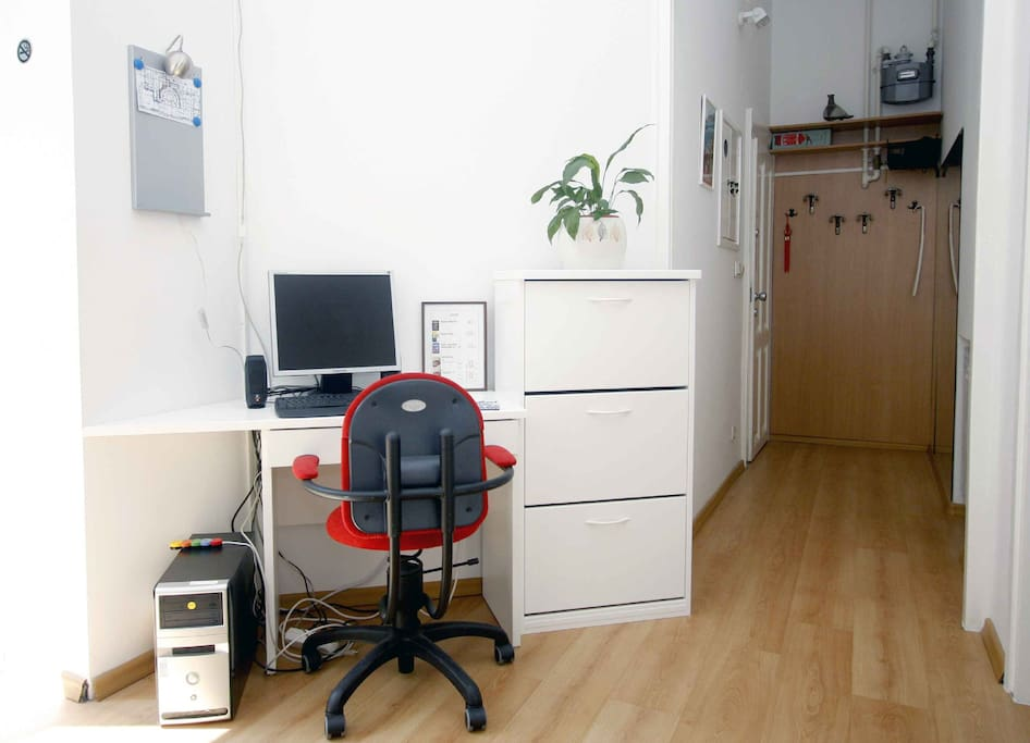 the entrance to the apartment and a desk with a PC, wi-fi available too