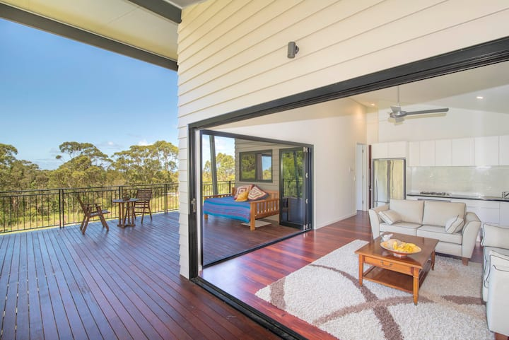 See Byron Bay sunrise over the ocean from your bed