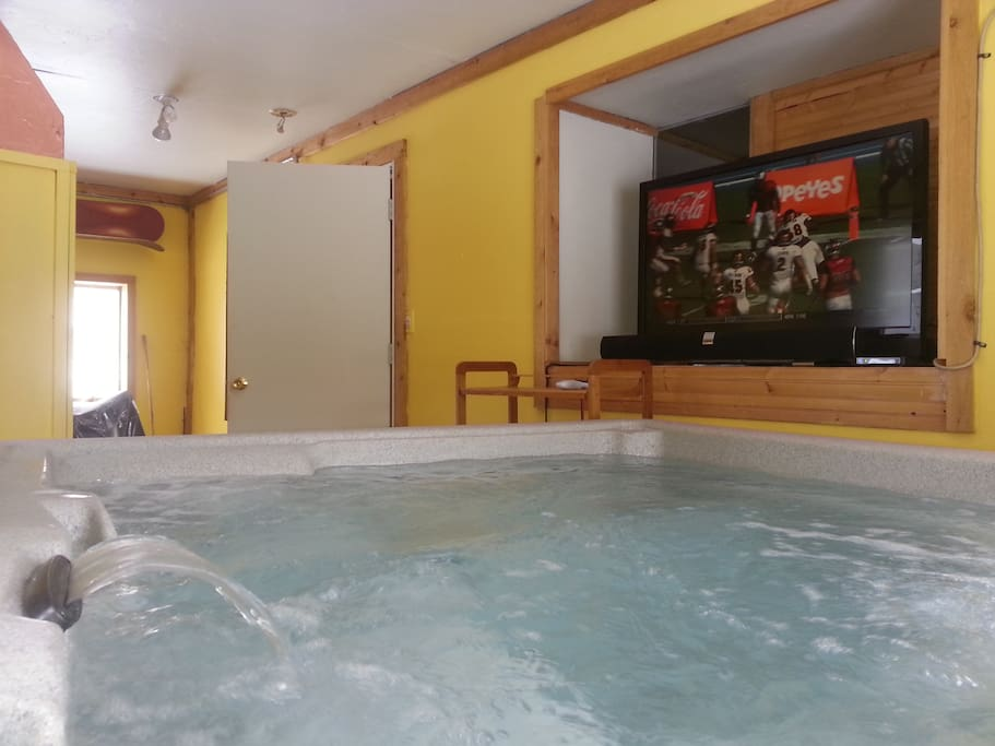 The hot tub room has its own home theater system, and a premium washer/dryer.