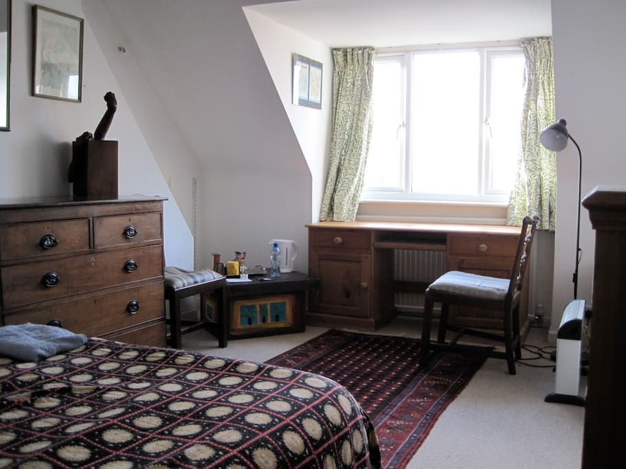 this is the guest bedroom, with desk, double bed, Teddy's sculptures and a chest of drawers.